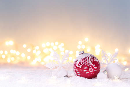Christmas card template with festive red and white decorations on the snow, lights bokeh, copy space 版權商用圖片