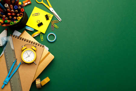 Back to school concept. Colorful stationary school supplies on green background, space or text flat lay 版權商用圖片