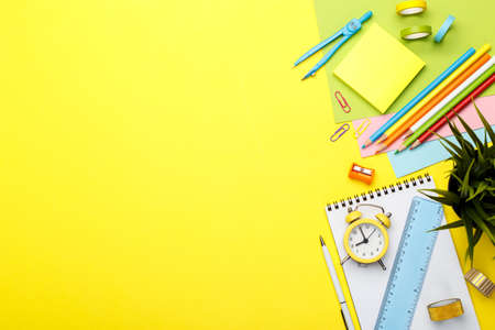Back to school concept. Colorful stationary school supplies on yellow  background, space or text flat lay