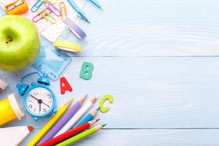 Back to school concept. Colorful stationary school supplies on blue trending background, space or text flat lay