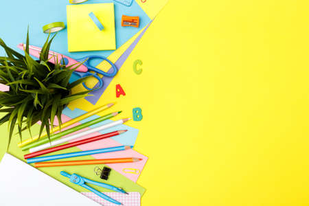 Back to school concept. Colorful stationary school supplies on yellow trendy background, space or text flat lay