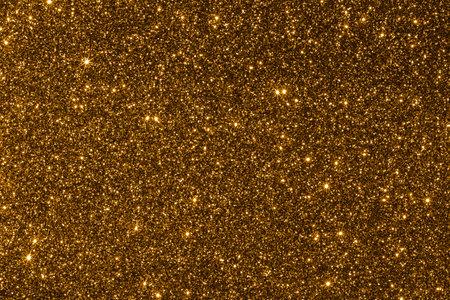 Yellow glitter texture holidays background. Macro shot Stockfoto