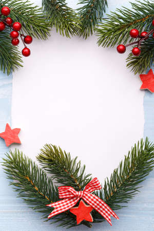 Christmas or new year wish list, wooden ornaments on blue background, festive decorations, vertical mock up