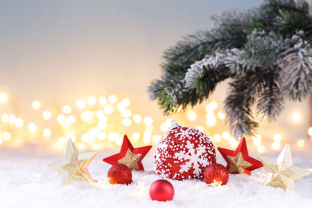 Christmas card template with festive red and gold decorations on the snow, lights bokeh Stockfoto