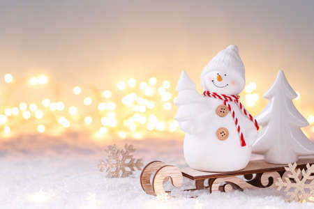 Snowman toy on the sledge Christmas or New Year festive greeting card template
