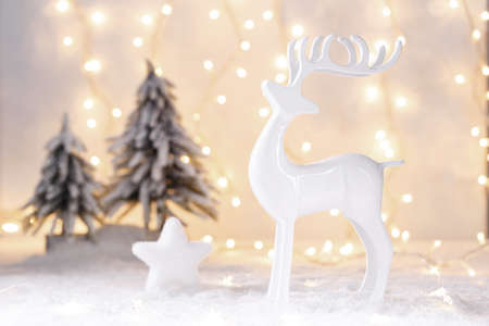 Christmas or new year card template, reindeer and star on snow with festive lights