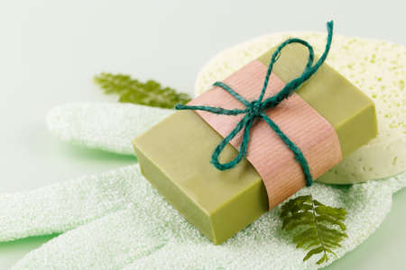 Hand made soap with olive and argan oil, zero waste reusable bathroom items on green
