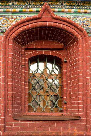 moldings: Window with the old grids, mosaics and moldings on a red background
