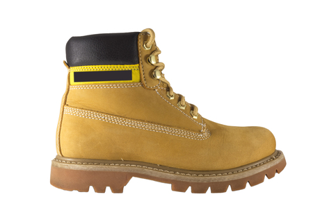 steel toe boots: Large yellow shoes with rough soles and laces on a white background Stock Photo
