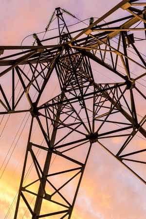 pink sunset: Metal power line against the pink sunset sky