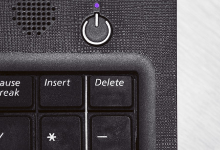 enabling: Laptop keyboard with delete button in black and white close up