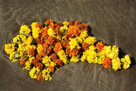 Indian religious wreath lies on the sand. India, Goa Stock Photo