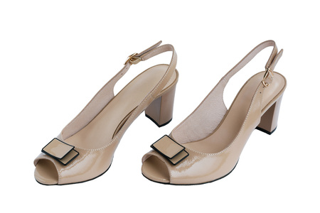 Beige feminine shoes with open toe and bow, isolated