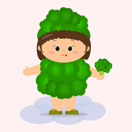 A cute kid in a broccoli suit is holding a vegetable in his hands.