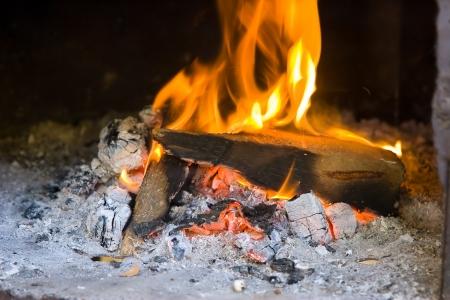 blazes: Orange fire blazes in stove Stock Photo