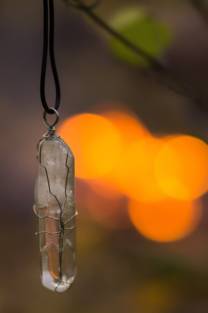 Transparent white magical rock crystal on pendant Stock Photo