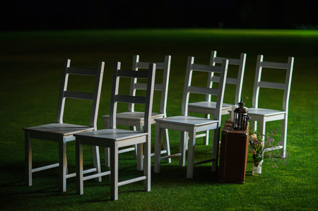 a meeting with a view to marriage: wedding lawn chairs the night