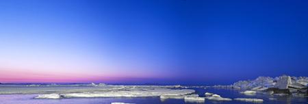 ice ridges at sunrise, winter, sea. panoramic picture