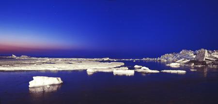 hummock: ice ridges at sunrise, winter, sea. panoramic picture
