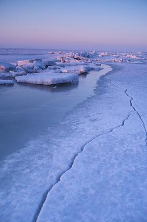hummock: ice ridges at sunrise, winter, sea Stock Photo