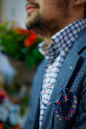blue ribbon with hearts in his breast pocket men Stock Photo