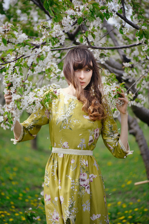 salud sexual: beautiful woman in long dress in blooming garden