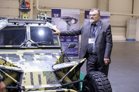 Kiev, Ukraine - October 12, 2017: military armored buggy of Ukrainian production with the developer at the exhibition Arms and Security - 2017 Editorial