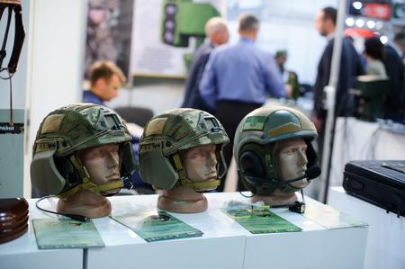 head protection: Kiev, Ukraine - October 12, 2017: modern military tactical Kevlar helmet at the exhibition, the production of Ukraine exhibition Arms and Security - 2017
