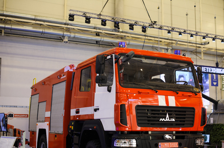 squad: Kiev, Ukraine - October 12, 2017: new red fire truck at the exhibition Arms and Security - 2017