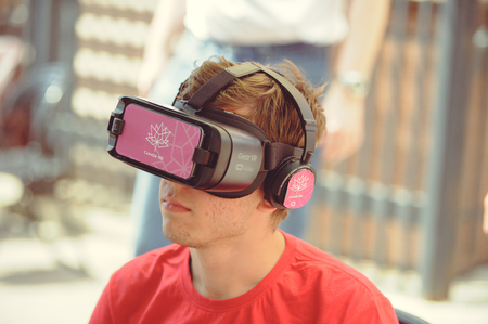 Kiev, Ukraine - June 12, 2017:  young man in glasses of virtual reality at an exhibition on the day of friendship of Ukraine and Canada Editorial