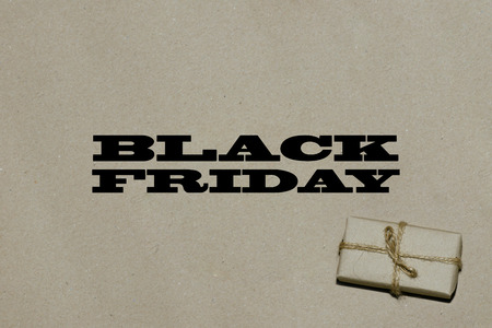 consumerism: Black friday hot sale.  The inscription is black Friday on craft paper with a gift, a place for text advertising and banner.