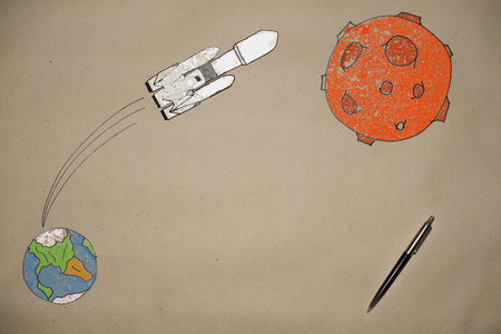 drawing the launch of a rocket falcon to mars on the background of the earth made on craft paper, among the stars, a flight to Mars