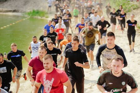 KYIV, UKRAINE - July 22, 2017: Men and women at the start overcame the watery mud barrier during the race to the legion