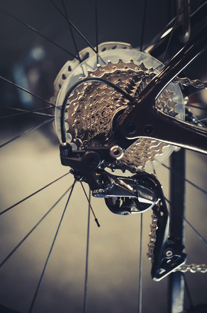Closeup of a bicycle gears mechanism and chain on the rear wheel of mountain bike. Rear wheel cassette from a mountain bike. Close up detailed view. Stock Photo