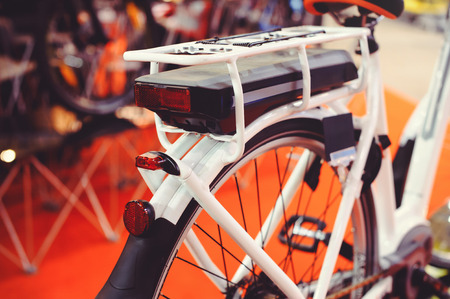 The electric bicycle battery is installed on the trunk, green technologies for the environment.