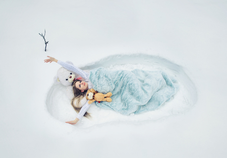 the spring has woken up, the woman lays in a snow covered with a blanket, soft fluffy and cozy dream, bed-clothes.