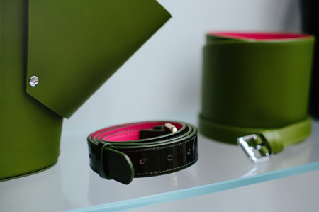 fashionable womens leather belt on the shelf. sale of leather goods.