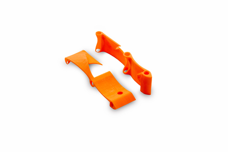beginning of the racing drone assembly. Elements of a spare part of an unmanned aerial vehicle frame printed on a 3d printer, isolated on a white background. Stock Photo