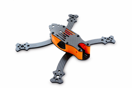 The beginning of the racing drone assembly. Durable frame of an unmanned aerial vehicle, made of carbon fiber and 3d printing, isolated on a white background.