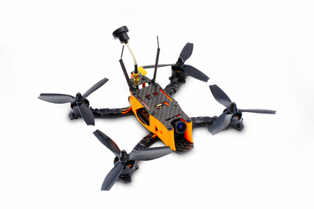 isolated drones racing FPV quadrocopter made of carbon black, drone ready for flight, stylish and modern hobby.