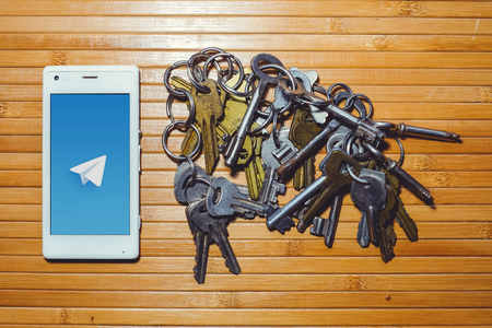 blocking and banning of telegram, encryption keys are located next to the phone. Stock Photo