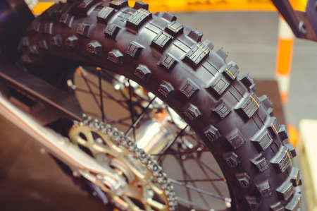 rear wheel of motorcycle, studded tire and chain. 版權商用圖片