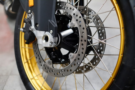 Disc brake with wheel hub on motorbike. Close up of front disc brake on motorcycle.