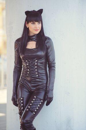 Costume of a beautiful young model wearing a cat costume. 版權商用圖片