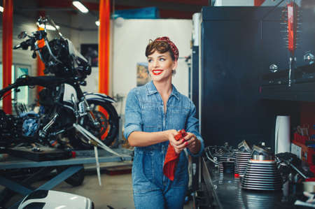 Beautiful motorcycle repair in the style of pin-up, service and sale. Women's Equality Profession