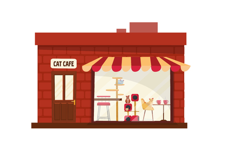 One-story Building cat cafe outside. House with large storefront with striped awning. Cats with accessories behind the glass.