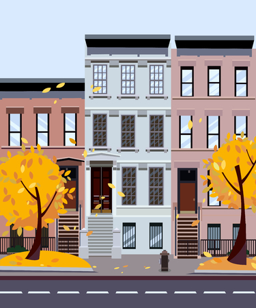 Flat cartoon style illustration of an autumn city street. Three-four-story houses. foliage flies from the trees. Street cityscape. Day city landscape with autumn trees in the foreground 스톡 콘텐츠