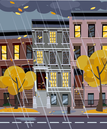 Flat cartoon illustration of autumn rainy city street at night. 3-4-story uneven houses with luminous windows,. Street cityscape. Evening town landscape with trees in the foreground, puddles 스톡 콘텐츠
