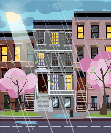 Flat cartoon illustration of spring rainy city street at evening. Uneven houses with lighting windows. Cityscape with rain through sunshine. Town landscape with blooming trees in the foreground