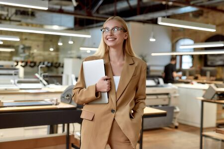 Be Smart, Lets Start. Cheerful businesswoman posing in office